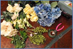 DIY Floral Centerpieces :  wedding artificial flower centerpiece blue diy diy floral centerpiece flowers ivory reception yellow Floral Arrangement 01