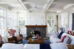 Coastal  Family Room - white couch with red, white, and blue accent pillows.  Hidden tv. oar on the wall.