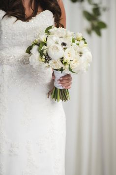 All-white wedding bouquet idea - white bouquet with peonies, anemones and roses {Amelia Cole Weddings + Events}