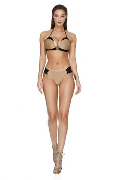 A black and gold brazilian bikini with a sweet push up bra and Brazilian bikini briefs. With elastic straps across the back, sizzle in this black and gold bikini and make a sultry seaside statement. Gold Swimsuit, Gold Bikini, Thong Bikini, Brazilian Briefs, Brazilian Bikini, Bikini Poses, Designer Swimwear, Swimsuits, Bikinis