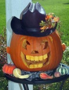cowboy pumpkin jack o lantern halloween decoration wearing a cowboy hat