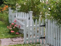 A picket fence painted in darker tones can also offer a modern garden boundary – the best of both worlds. shop for your own picket fence panels here.