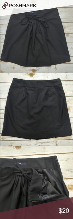 """GAP Pleated lined miniskirt with bow tie GAP Pleated lined miniskirt with bow tie  Size 2 with a 14"""" waist and a 17"""" length in excellent condition. Please let me know if you have any questions. I ship the same day as long as the post office is still open. Have a great day, thanks for checking out my closet and happy poshing! GAP Skirts Mini"""