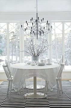 Even with a tablecloth or sheer fabric, the tulip table still shines.  #onekingslane    #designisneverdone