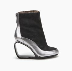 Mobius Short Boot Dark Grey + Steel Split Suede + Metallic Nappa - The United Nude Möbius has become an icon in the world of design. The new tall bootie is crafted from two leather textures. It presents a metal zip