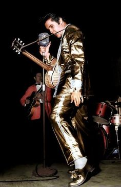 This subsequently colorized photo shows Elvis performing at the International Amphitheatre in Chicago, IL on March 28, 1957. Elvis only wore the full gold lamé suit twice on stage, once in Chicago and the next day, on March 29, 1957, at Kiel Auditorium in St. Louis, MO.