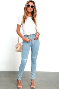Have a (very stylish) New York minute in the Brooklyn Bridge Light Wash Distressed High-Waisted Skinny Jeans! Five-pocket styling lays below a high waistband with belt loops, branded top button, and hidden zip fly. Skinny pant legs have distressing at the knees. #CuteDresses #TrendyTops, #FashionShoes #JuniorsClothing
