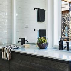 @hamlanhomes posted to Instagram: COASTAL HERITAGE ‣ The natural tones and textures of this modern bathroom are perfect for its Torquay location. Our homes often reference our Great Ocean Road origins, right down to the careful selection of coastal materials and colours.   _  HOME/ Bancoora Retreat TILES/ @volaretileconcepts TAPWARE/ @caromaaustralia CUPBOARDS/ @laminexau BENCHTOP/ @essastoneau   #hamlanhomes #buildingdreams #geelongbuilder #architecturaldesign #australianhomes #builder… Australian Homes, Cupboards, Origins, Modern Bathroom, Be Perfect, Architecture Design, Coastal, Bathrooms, Tiles