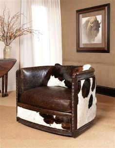 Hairhide and leather SWIVEL club chair...sweet!
