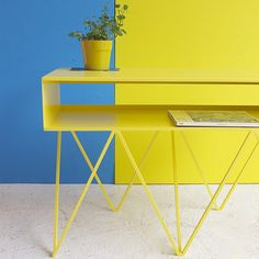 The sculptural low steel sideboard Robot Too is great as a media/AV stand. The slim pigeonhole shelf on top has a clever half-open back to hide wiring.  Yellow sideboard table. Yellow side table. Low yellow table.