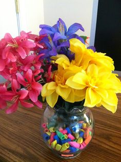 Eraser Flower Vase - I filled a dollar store vase with pencil cap erasers and then arranged dollar store flowers! This will be so cute on my desk in my classroom! :)  #education #classroom #teaching #teacher
