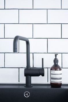 """A """"Charmingly Off-Level"""" Oslo Apartment   Design*Sponge """"The black kitchen tap is from Grohe, and the black sink is from Blanco."""""""
