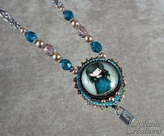Embroidery pendant and cabochon doll Gorjuss