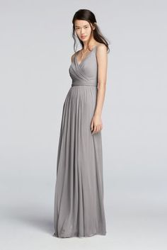 A perfect combination of comfort and elegance this dress has tons of wear again potential!  Soft and flowing long mesh dress with tank style straps and figure flattering v-neckline.  Pleat and release skirt features an attached belt.  Also available in Extra Length sizes as Style 2XLF18056.  Fully lined. Back zipper. Imported. Dry clean only. To protect your dress, try our Non Woven Garment Bag.