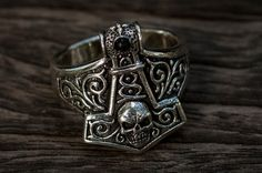 Silver Thor hammer ring. Decorative  design. Silver ring with skull.