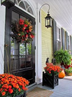 Seven Fall Porch Decorating Ideas.  Antique Homes and Lifestyle I LOVE THE COLORS OF THIS PORCH. LIGHT YELLOW WALLS, BLACK TRIM, DOOR AND SHUTTERS AND LIGHT GRAY FLOOR.