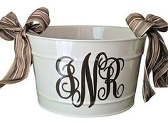 Spray painted galvanized bucket with vinyl monogram and bows