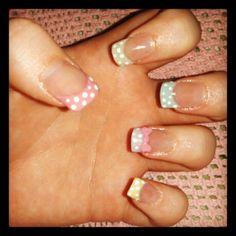 Polka dot acrylic nails with nail art bow on feature nail