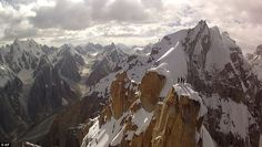 Spectacular: In this photo taken from a camera mounted to a remote-controlled helicopter and provided by Remo Masina, Peter Ortner, Corey Rich and David Lama stand atop the Trango Summit in northern Pakistan's Karakoram mountain range.