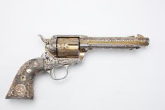 """COLT SINGLE ACTION ARMY REVOLVER: Made in this handgun had the misfortune to be engraved by a """"craftsman"""" that went a little overboard. Cutting too deeply into the barrel meant this revolver is no longer an item that can be safely fired. Colt Single Action Army, Single Action Revolvers, Revolver Pistol, Gun Art, Cool Guns, Knives And Swords, Guns And Ammo, Firearms, Hand Guns"""