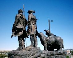 Overlook Park in Great Falls, Montana on the Lewis and Clark Trail featuring the bronze statue of Lewis, Clark, York and Seaman dog Great Falls Montana, Big Sky Montana, Lewis And Clark Trail, Statues, Missouri River, Sea To Shining Sea, Big Sky Country, Family Road Trips, American History