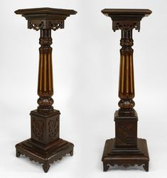 *Pair of English Regency style (19th Cent) mahogany and gilt trimmed fluted column pedestals with fretwork apron and square top