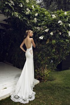 low back wedding dress with sheer lace cut out panels - see the full collection on bridalmusings.com