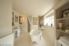 Luxury: The bathroom fits the rest of the house's nuetral decor...