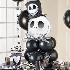 Here's a nightmare you'll want to have...at your dessert table that is! This frighteningly fun centerpiece is made from two layers of 4 black balloons tied together & a Jack Skellington orbz balloon on top!