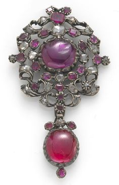 A ruby and diamond pendant  mounted in silver;