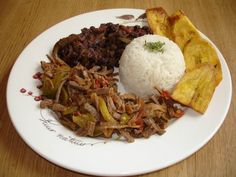 Pabellon criollo - Venezuelan traditional plate (Rice, black beans, shredded beef & fried plantains)