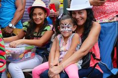 Beautiful Face Paintings done by Katherine! All at the 30th Feria del Barrio! (2014)