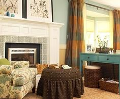 Likey the brown hassock in this orange, turquoise, and brown room.