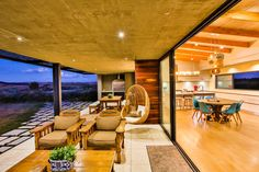 Open living spaces flowing from inside to outside with breathtaking views of the natural context. Off-shutter concrete, timber cladding, terrazzo tiles, concrete braai.