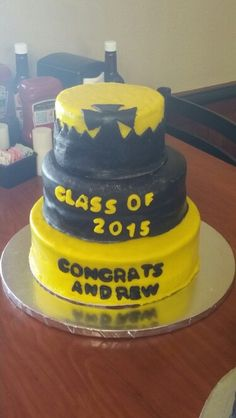 Black and yellow marble cake with chocolate ganache, cannoli, and strawberry fillings and black and yellow fondant