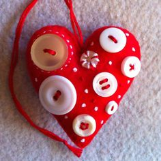 Red felt heart ornament with buttons.