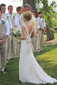 White-off French lace backless wedding dress with satin back bow.