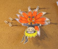 Here's little Naruto, hanging from a sealion magnet...thing...yeah>< Silly Naruto!XD