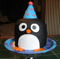 Penguin birthday cake. Frosted in buttercream with fondant accents.