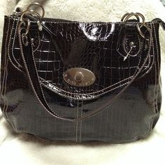 NINE WEST - Black Satchel -  NWOT This satchel has never been used.  It still has the plastic from the tags.  It has a large open pocket inside the main zipper with a small zip pouch on inside side.  Also, the front has a magnetic snap that opens to another pouch. Nine West Bags Satchels