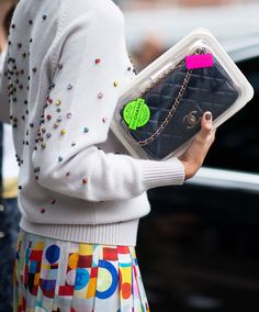 No. 26 - Eleonora Carisi  We get that she wants to preserve the runway accuracy of her Chanel bag, but serious question: How on earth do you get anything in and out of the plastic casing without everything winding up on the floor?    Photo:  Youngjun Koo/I'M KOO