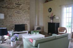 Vakantiehuis in de Lot - Dordogne  Frankrijk. Huiskamer met de haard.