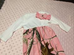 Baby onesie gown, made with Pink camo flannel, Personalized FREE. $26.00, via Etsy.