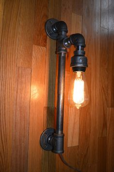 Steampunk Lamp Industrial Pipe Lamp wall sconce. I'd love to make one of these.