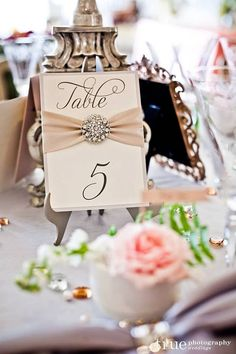 Table Numbers with Ribbon & Crystal Broach by TakeNoteCreations, $9.95  Do you want blush color?