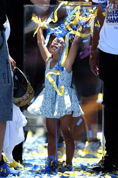 . Golden State Warriors\' Stephen Curry drops confetti over  his 2-year-old daughter Riley at the end of their NBA championship rally at the Henry J. Kaiser Convention Center across from Lake Merritt in Oakland, Calif., on Friday, June 19, 2015. (Ray Chavez/Bay Area News Group)