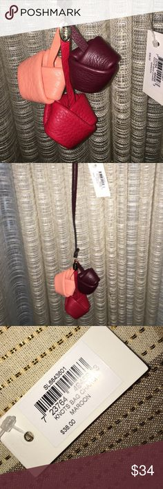 "FOSSIL CHARM/KEYCHAIN Fossil charm/keychain. Called ""knots bag charm"" in maroon. I loved this online but it is much bigger than I expected. I can't send back as I also bought someone's gift at the same time and they have the returning address box etc in case they don't like their gift. I will take offers through the offer button, but please keep in mind the price and that it is brand new. Fossil Accessories"
