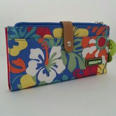 """Lily Bloom Tiki Bar Pattern Eco-friendly Wallet Lily Bloom bags are created using their signature fabric """"Karma Bloom"""" made of recycled bottles. New with tags. Blue Tiki Bar Beach themed wallet. Silver toned hardware. Exterior: Flapover strap with snap closure, side zip pocket, slip pocket, and top zippered closure. Interior: Hot Pink, 6 slots for id, credit card, or business cards, clear slot for id, checkbook and money storage, pen holder. Removable id holder, with top zip, and side slip…"""