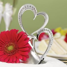 Two hearts that beat as one...right atop your wedding cake! This silver rhinestone double hearts cake topper is a shining symbol of your love.