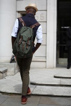 fedora, rolled up sleeves, pants, shoes even that cute backpack! Awesome